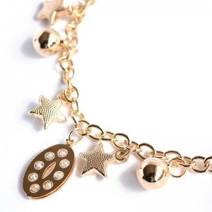 star and moon charm bracelet close up
